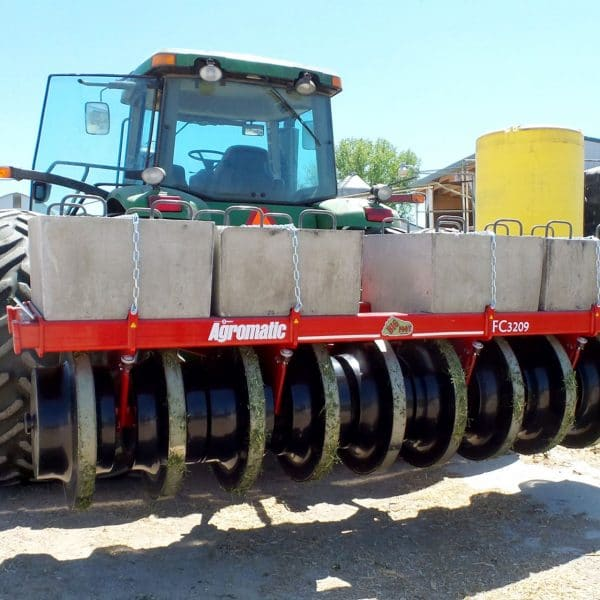 Farmer packing silage with Agromatic Big Foot Forage Packer.