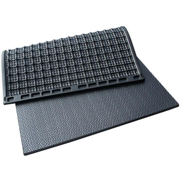 Kraiburg KIM individual stall mats with pebbled surface.
