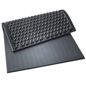 Kraiburg KKM individual stall mats with pebbled surface.