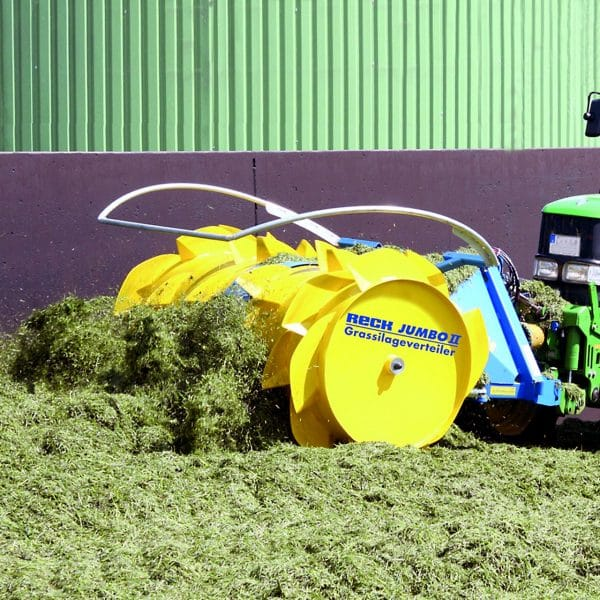 Farmer spreading silage with Agromatic RECK Jumbo II Silage Spreader.