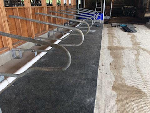 KIM Longline rubber stall mat rolls installed.