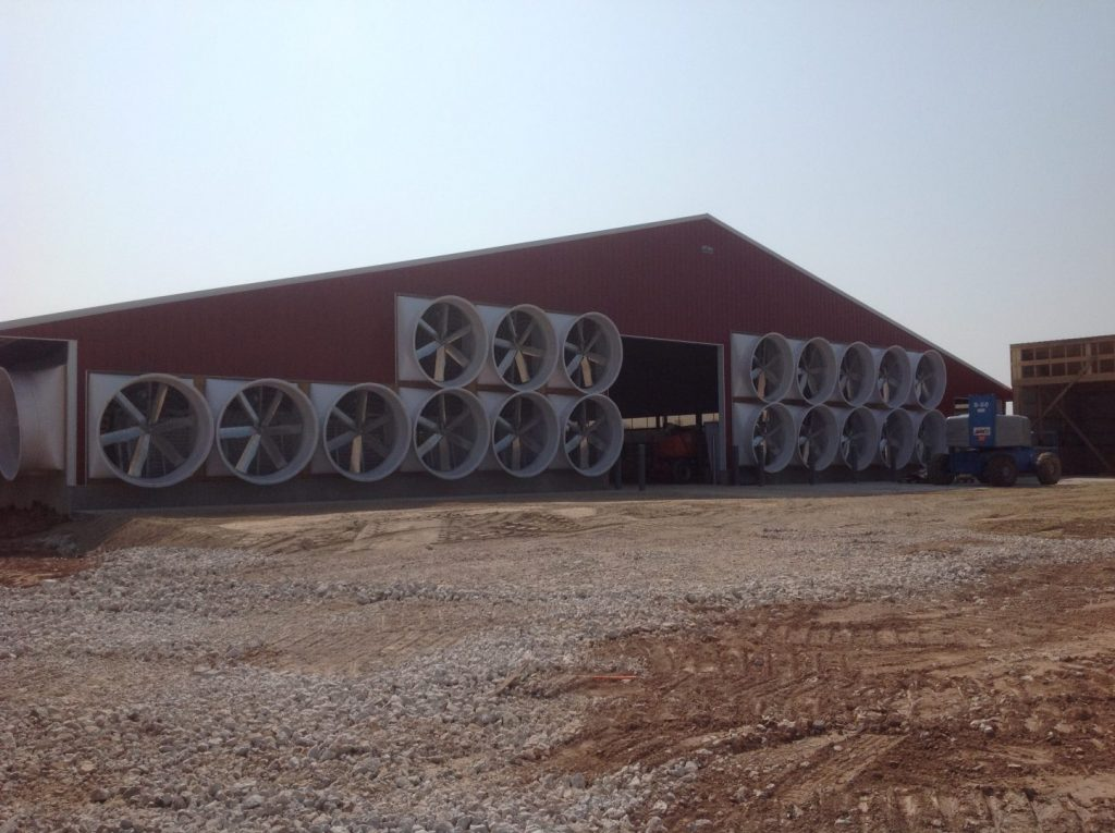 New red barn fans. Exhaust fans on external walls.