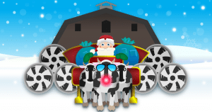 Santa Claus with cows pulling sleigh, powered by Agro Air Dynamics barn fans.