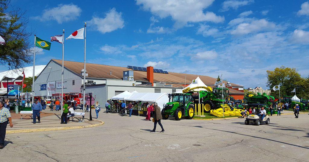 World Dairy Expo 2018 arena building and John Deere exhibit.