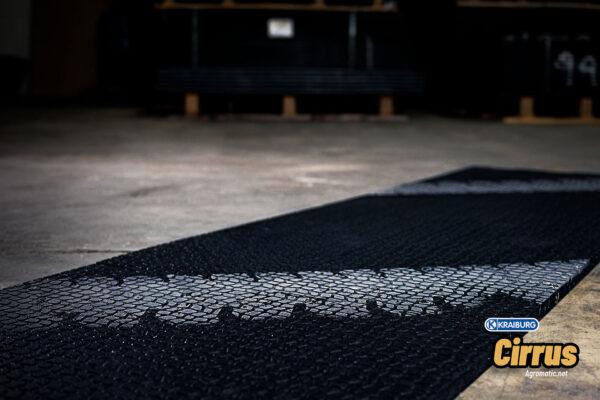 KRAIBURG Cirrus alley scraper flooring with tire marks over the top.