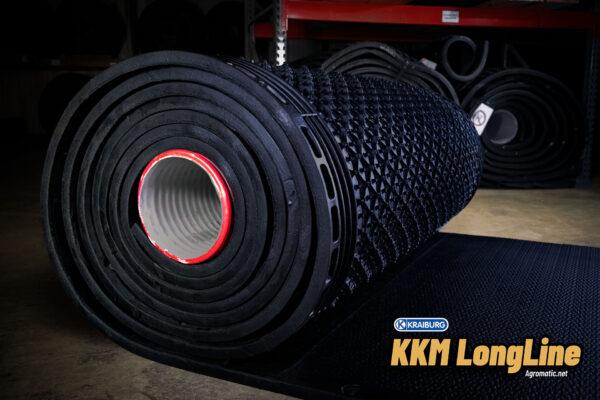 KRAIBURG KKM LongLine stall mat roll in a warehouse.